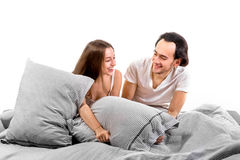 Happy couple in bed smiling and flirting Royalty Free Stock Images