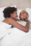 Happy couple in bed together Stock Images