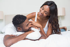 Happy couple on bed together Royalty Free Stock Photo