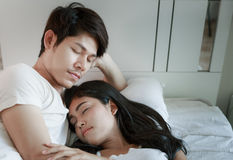 Happy Couple On Bed Stock Image