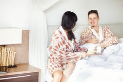 Happy couple in the bedroom Royalty Free Stock Photography