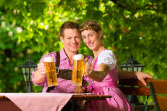 Happy Couple in Beer garden drinking beer Stock Photo