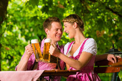 Happy Couple in Beer garden drinking beer Stock Images