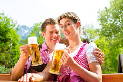 Happy Couple in Beer garden drinking beer Royalty Free Stock Images