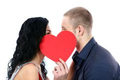 Happy couple behind a red heart Royalty Free Stock Images