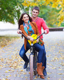 Happy couple with bicycle in autumn park Stock Photography