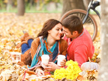 Happy couple with bicycle in autumn park Royalty Free Stock Photography