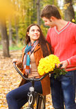 Happy couple with bicycle in autumn park Stock Photos