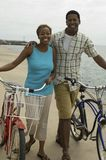 Happy Couple With Bicycles On Beach Royalty Free Stock Image