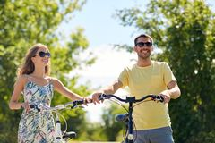 Happy couple with bicycles at country stock photography