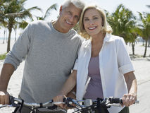 Happy Couple With Bicycles On Tropical Beach Stock Photo