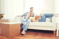 Happy couple with big cardboard boxes at new home Stock Photo