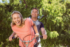Happy couple on a bike ride Stock Image