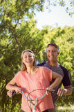 Happy couple on a bike ride Royalty Free Stock Image