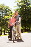 Happy couple on a bike ride Stock Images