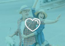 Happy couple on bike waving hand. With digitally generated heart stock illustration