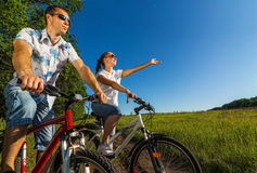 Happy couple on bikes Royalty Free Stock Images