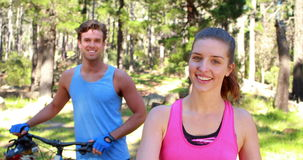 Happy couple with bikes. In the countryside stock video footage