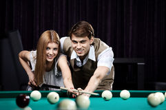 Happy couple in a billiard room Stock Photos