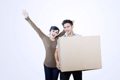 Happy couple and blank box - isolated Royalty Free Stock Photos