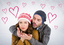 Happy couple blowing a kiss together Royalty Free Stock Photos