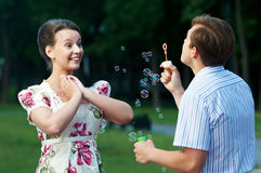 Happy couple blowing soap bubbles Royalty Free Stock Photo