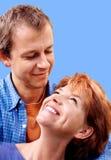 Happy couple on blue royalty free stock photo