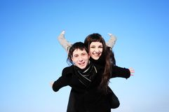 Happy couple on blue sky Stock Image