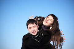 Happy couple on blue sky Stock Photos