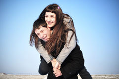 Happy couple on blue sky Royalty Free Stock Images