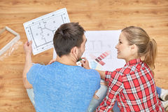 Happy couple with blueprint and color samples Royalty Free Stock Image