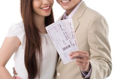 Happy couple with boarding passes Royalty Free Stock Images