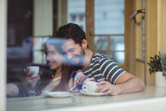 Happy couple bonding at cafe. Happy young couple bonding at cafe Royalty Free Stock Photography