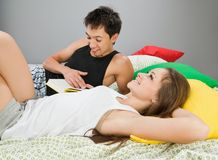 Happy couple with book in bed Royalty Free Stock Images
