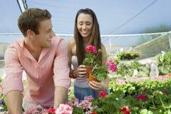 Happy Couple At Botanical Garden Royalty Free Stock Photos