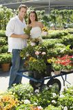 Happy Couple At Botanical Garden Royalty Free Stock Photo