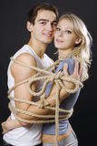 Happy Couple Bound With Ropes Royalty Free Stock Photo
