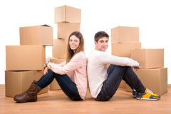 Happy couple with boxes Royalty Free Stock Images