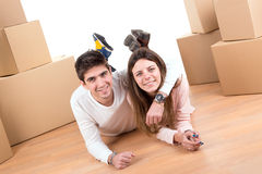 Happy couple with boxes Royalty Free Stock Image