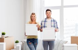 Happy couple with boxes moving to new home. Mortgage, people and real estate concept - happy couple with boxes moving to new home stock photos