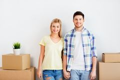 Happy couple with boxes moving to new home. Mortgage, people and real estate concept - happy couple with boxes moving to new home stock images