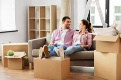 Happy couple with boxes moving to new home royalty free stock image