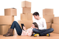 Happy couple with boxes Royalty Free Stock Photo