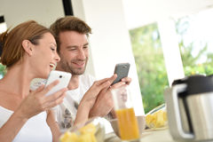 Happy couple at breakfast stock photography