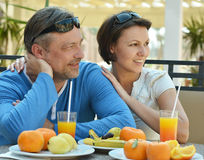 Happy couple at breakfast. On the table Royalty Free Stock Image