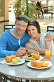 Happy couple at breakfast. On the table Royalty Free Stock Photography