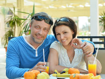 Happy couple at breakfast. On the table Stock Photos