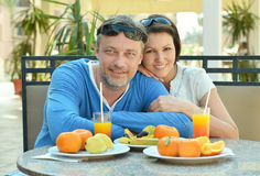 Happy couple at breakfast. On the table Stock Photo