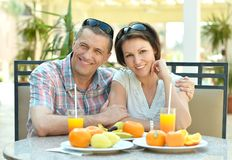 Happy couple at breakfast. On the table Royalty Free Stock Images