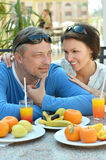 Happy couple at breakfast. On the table Stock Images